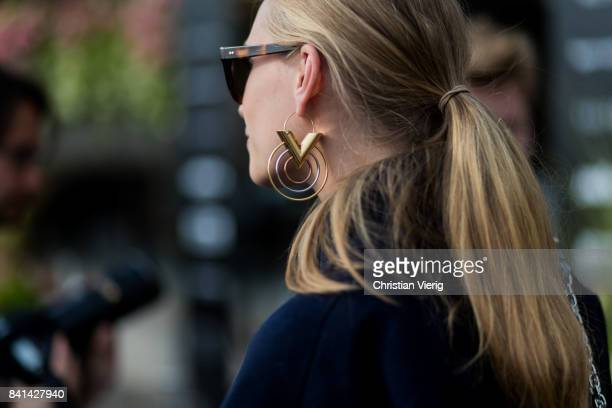 Tine Andrea wearing Louis Vuitton earring outside House of Dagmar on August 31 2017 in Stockholm Sweden