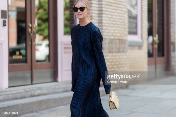 Tine Andrea wearing navy dress seen in the streets of Manhattan outside Tibi during New York Fashion Week on September 9 2017 in New York City