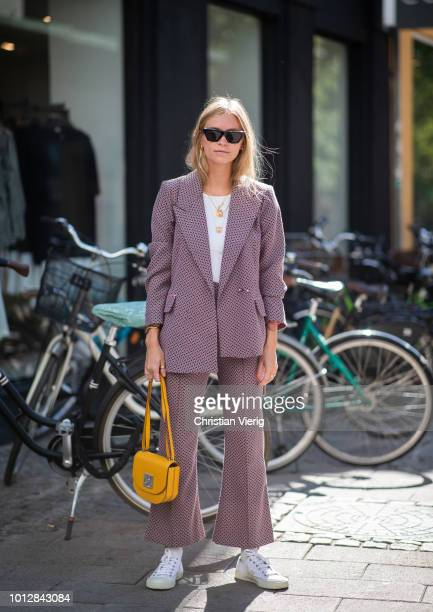 Tine Andrea wearing pink suit with flared pants seen outside Blanche during the Copenhagen Fashion Week Spring/Summer 2019 on August 7 2018 in...