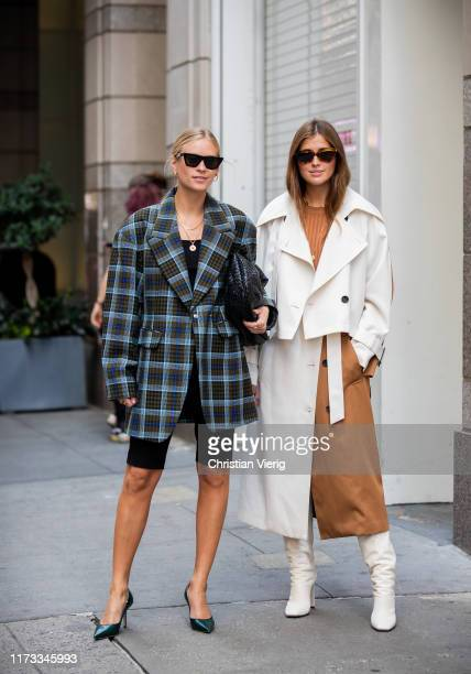 Tine Andrea wearing plaid blazer and Darja Barannik wearing two tone coat is seen outside Tibi during New York Fashion Week September 2019 on...