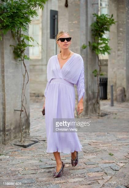 Tine Andrea wearing purple dress seen outside Designers Remix during Copenhagen Fashion Week Spring/Summer 2020 on August 08 2019 in Copenhagen...