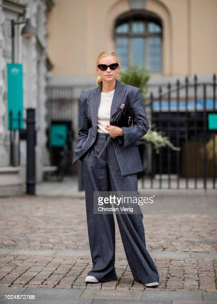 Tine Andrea wearing striped oversized suit is seen during Stockholm Runway SS19 on August 28 2018 in Stockholm Sweden