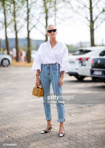 Tine Andrea wearing white blouse denim jeans is seen outside Holzweiler during the Copenhagen Fashion Week Spring/Summer 2019 on August 8 2018 in...