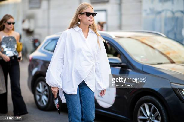 Tine Andrea wearing white blouse is seen outside Ganni during the Copenhagen Fashion Week Spring/Summer 2019 on August 9, 2018 in Copenhagen, Denmark.