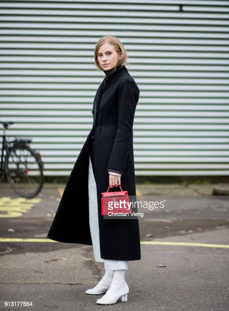 Tine Andrea wearing white boots red Hermes bag outside Designers Remix during the Copenhagen Fashion Week Autumn/Winter 18 on February 1 2018 in...