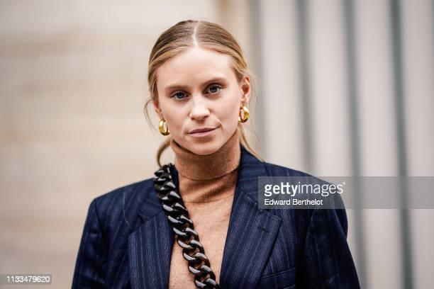 Tine Andrea wears earrings, outside Paul & Joe, during Paris Fashion Week Womenswear Fall/Winter 2019/2020, on March 03, 2019 in Paris, France.