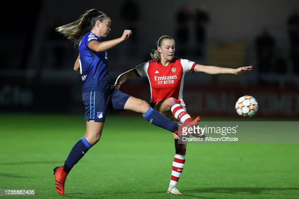 Tine De Calgny of Hoffenheim and Frida Maanum of Arsenal during the UEFA Women's Champions League group C match between Arsenal WFC and 1899...