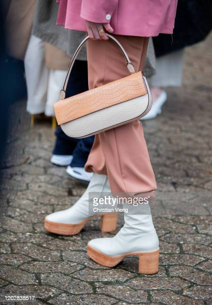 Tine Kjaer seen wearing two tone boots and bag outside Holzweiler during Copenhagen Fashion Week Autumn/Winter 2020 Day 2 on January 29 2020 in...