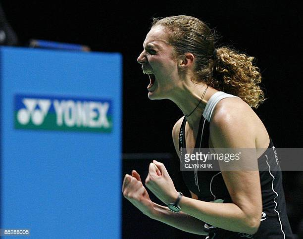 Tine Rasmussen of Denmark celebrates as she competes in her women's semi final match against Jiang Yanjiao of China during the All England Open...