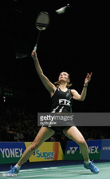 Tine Rasmussen of Denmark competes in her women's semi final match against Jiang Yanjiao of China during the All England Open Badminton Championships...