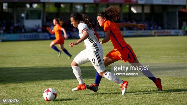 Tineke de Jong of the Netherlands challenges Gia Corley Gia Corley during the U15 girl's international friendly match between Germany and Netherlands...