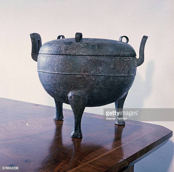 Ting cauldron with lid The body of the vessel and the lid are decorated with interlacing dragons Such vessels were used for cooking storage and...
