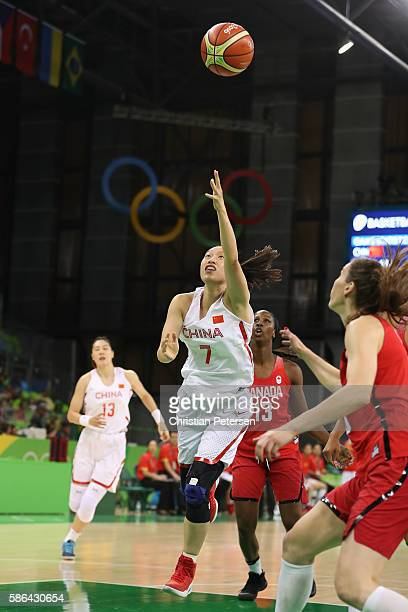 Ting Shao of China attempts a lay up shot against Canada during a Women's Basketball Preliminary Round game on Day 1 of the Rio 2016 Olympic Games at...