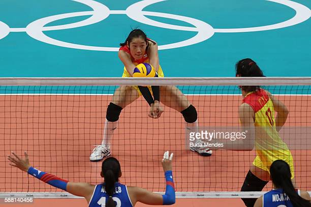 Ting Zhu of China in action during the women's qualifying volleyball match between the China and Puerto Rio on Day 5 of the Rio 2016 Olympic Games at...