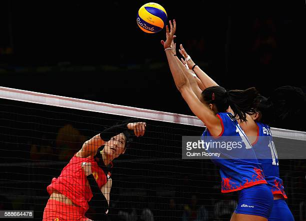 Ting Zhu of China spikes the ball during the Women's preliminary volleyball match between Serbia and China on Day 7 of the Rio 2016 Olympic Games at...