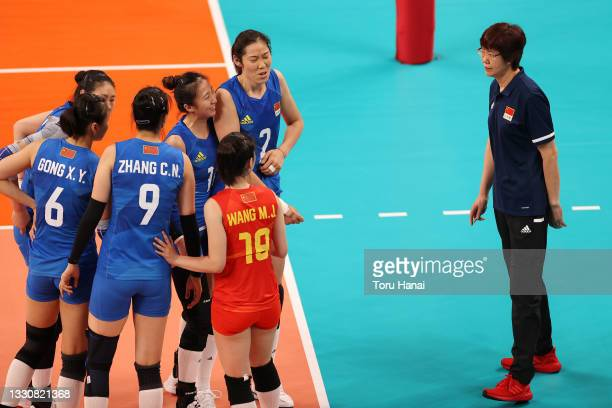 Ting Zhu of Team China and Xia Ding celebrate against Team United States during the Women's Preliminary - Pool B volleyball on day four of the Tokyo...