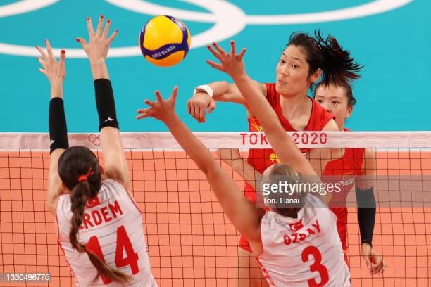 Ting Zhu of Team China attacks at the net against Team Turkey during the Women's Preliminary - Pool B on day two of the Tokyo 2020 Olympic Games at...