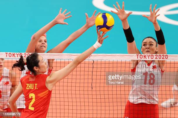 Ting Zhu of Team China attempts to tip over Zehra Gunes of Team Turkey during the Women's Preliminary - Pool B on day two of the Tokyo 2020 Olympic...