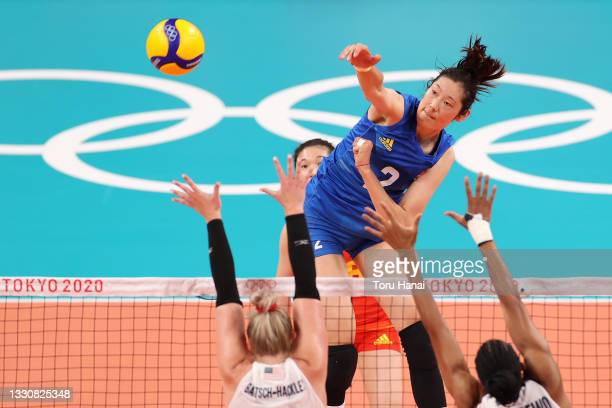Ting Zhu of Team China hits against Team United States during the Women's Preliminary - Pool B volleyball on day four of the Tokyo 2020 Olympic Games...