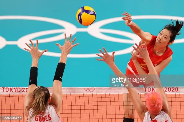 Ting Zhu of Team China hits between Zehra Gunes of Team Turkey and Ebrar Karakurt during the Women's Preliminary - Pool B on day two of the Tokyo...