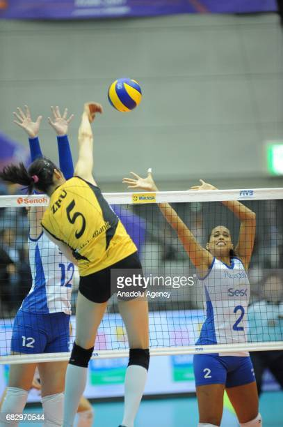 Ting Zhu of Vakifbank Istanbul in action against Brazilian players Roberta Ratzke and Mayhara Da Silva during the final match for the 1st and 2nd...