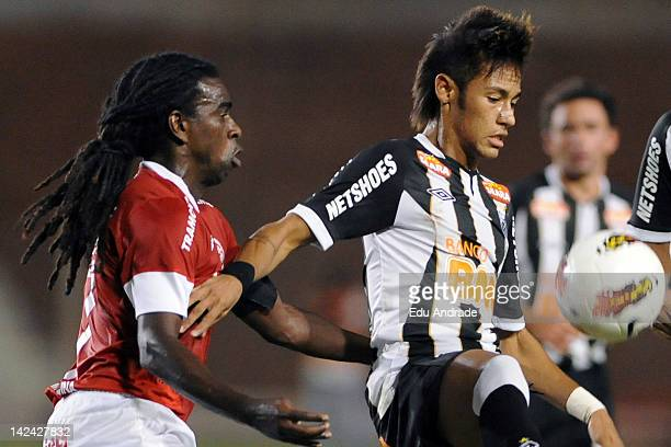 Tinga from Internacional fight for the ball with Neymar of Santos during a match between Internacional and Santos at Beira Rio stadium as part of the...