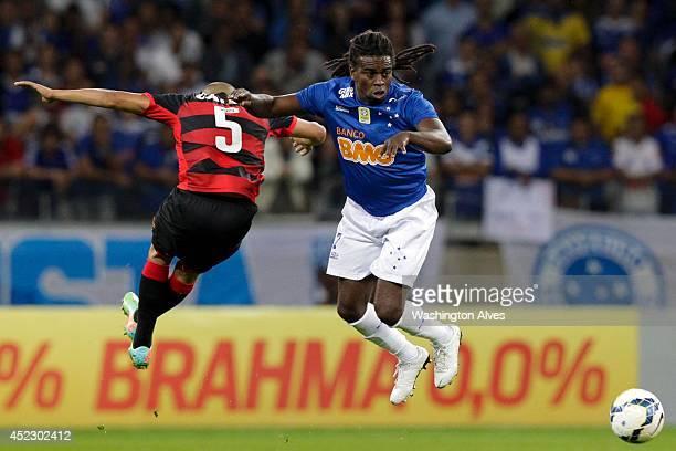 Tinga of Cruzeiro struggles for the ball with Adriano of Vitoria during a match between Cruzeiro and Vitoria as part of Brasileirao Series A 2014 at...