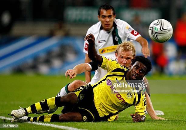 Tinga of Dortmund battles for the ball with Tobias Levels and Juan Arango of Moenchengladbach during the Bundesliga match between Borussia...