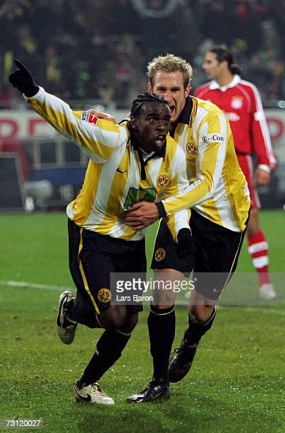 Tinga of Dortmund celebrates scoring the fives goal with team mate Florian Kringe during the Bundesliga match between Borussia Dortmund and Bayern...