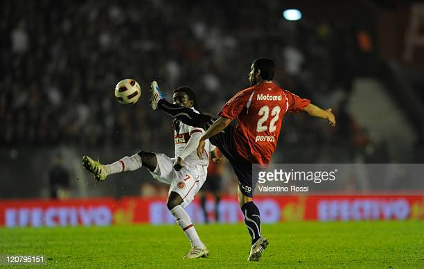 Tinga of Internacional fights for the ball with Ivan Perez of Independiente during a match as part of the 2011 Recopa Sudamericana first final match...
