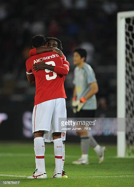 Tinga of Sport Club Internacional celebrates scoring his sides opening goal with his teammate Alecsandro during the FIFA Club World Cup match for...