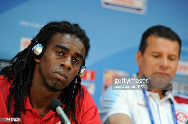 Tinga of Sport Club Internacional listens to questions from the media flanked by Head coach Celso Roth during a press conference at Zayed Sports City...
