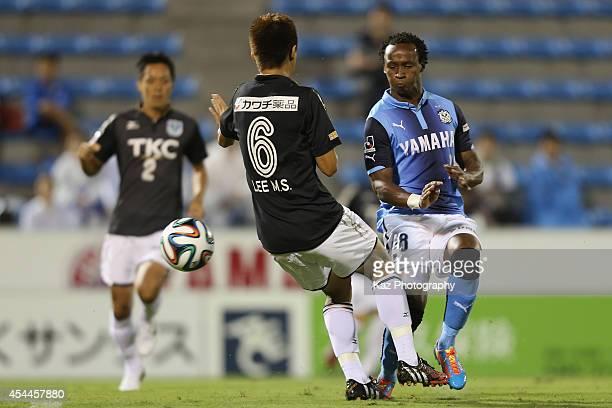 Tinga whose real name is Luiz Otavio Santos de Araujo and Lee Minsoo of Tochigi SC compete for the ball during the JLeague second division match...
