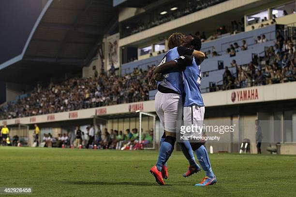 Tinga whose real name is Paulo Cesar Fonseca do Nascimento celebrates scoring his team's first goal with his teammate Ryohei Yamazaki during the J...