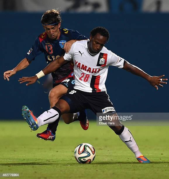 Tinga whose real name is Paulo Cesar Fonseca do Nascimento of Jubilo Iwata and Yosuke Nozaki of Yokohama FC compete for the ball during the J League...