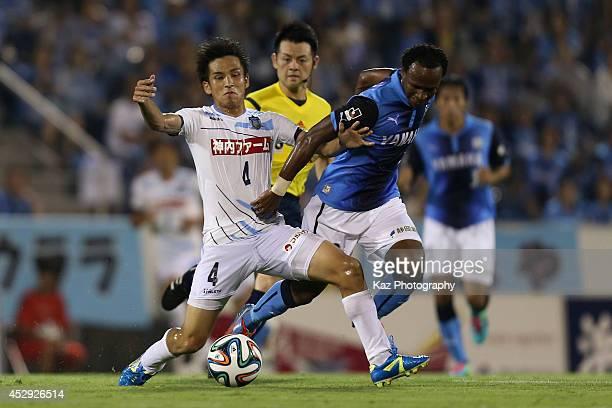 Tinga whose real name is Paulo Cesar Fonseca do Nascimento of Jubilo Iwata and Kazuya Okamura of Kamatamare Sanuki compete for the ball during the J...