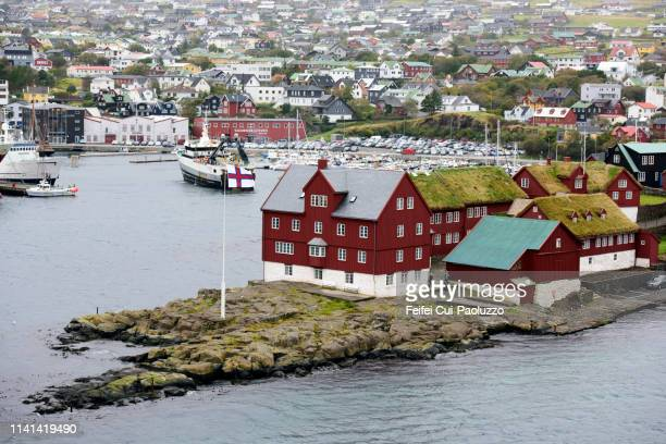 tinganes peninsula on the bay of tórshavn, faroe islands - torshavn stock pictures, royalty-free photos & images