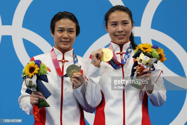 Tingmao Shi and Han Wang of Team China pose with the gold medals on the podium during the medal ceremony for the Women's 3m Springboard Finals on day...