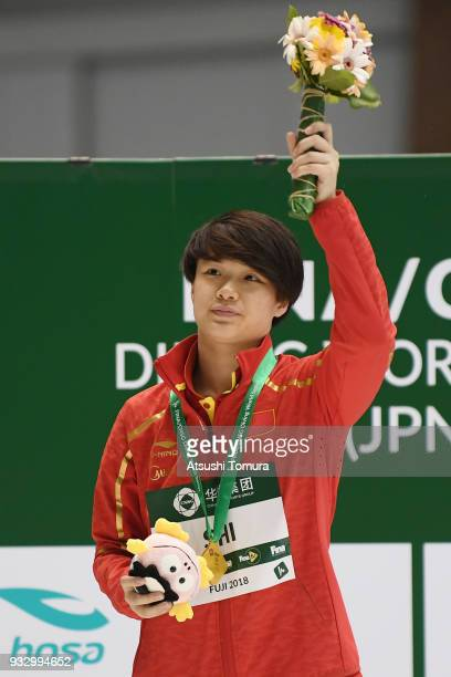 Tingmao Shi of China celebrates on the podium after the Women's 3m Springboard final during day three of the FINA Diving World Series Fuji at...