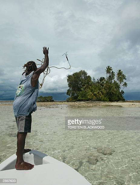 Tingo Leve throws an anchor towards the sacred burial site of Skull Island in Vona Vona Lagoon in the remote Western Province of the Solomon Islands,...