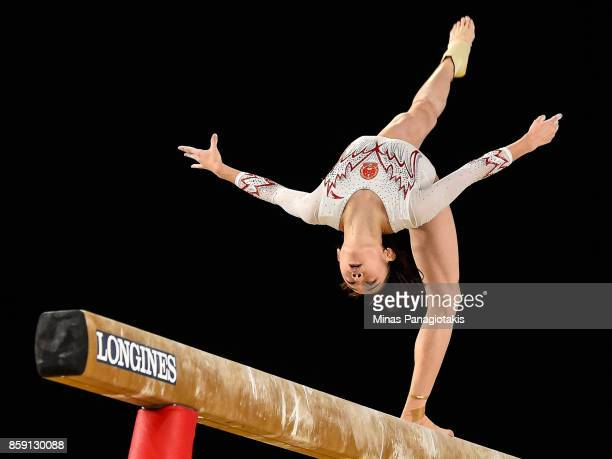 Tingting Liu of People's Republic of China competes on the balance beam during the individual apparatus finals of the Artistic Gymnastics World...