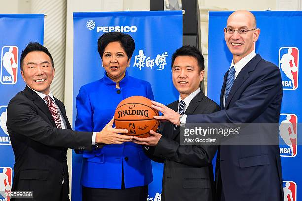 Tingyi CMO Richard Lee PepsiCo CEO Indra Nooyi Tingyi board of directors member Hong Chen Wei and NBA Commissioner Adam Silver pose for a picture...