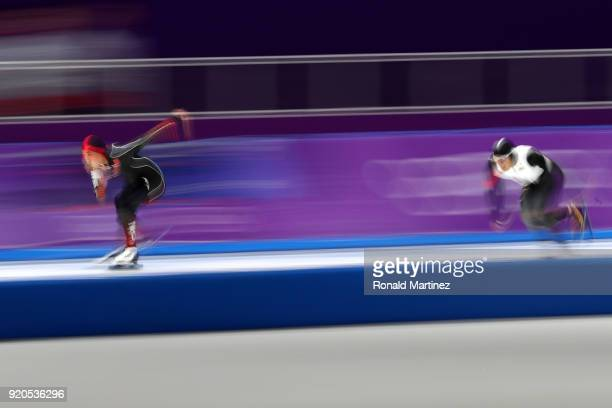Tingyu Gao of China and Joji Kato of Japan compete during the Men's 500m Speed Skating on day 10 of the PyeongChang 2018 Winter Olympic Games at...