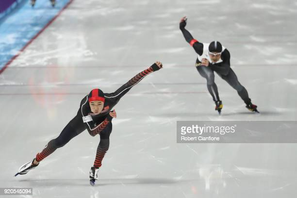 Tingyu Gao of China and Joji Kato of Japan compete during the Men's 500m Speed Skating Final on day 10 of the PyeongChang 2018 Winter Olympic Games...