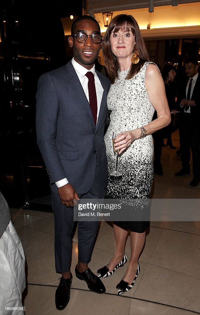 Tinie Tempah (L) and BAFTA CEO Amanda Berry attends the BAFTA 'Breakthrough Brits' event at Burberry 121 Regent Street, London on October 21, 2013 in London, United Kingdom.