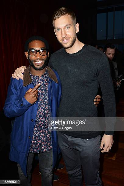 Tinie Tempah and Calvin Harris attend a listening party for Daft Punk's new album 'Random Access Memories' at The Shard on May 13 2013 in London...