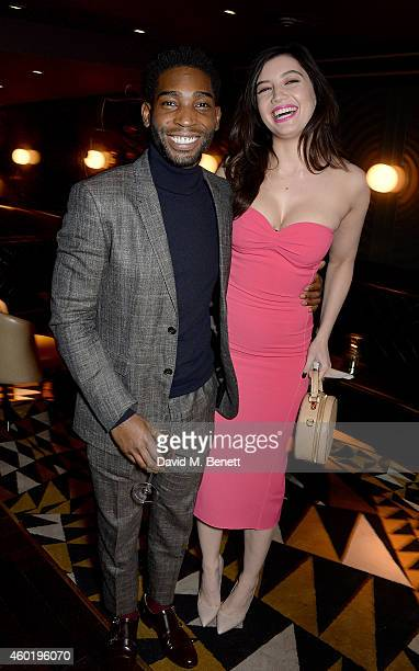 Tinie Tempah and Daisy Lowe attend the GQ Christmas Lunch at Quaglino's on December 9 2014 in London England