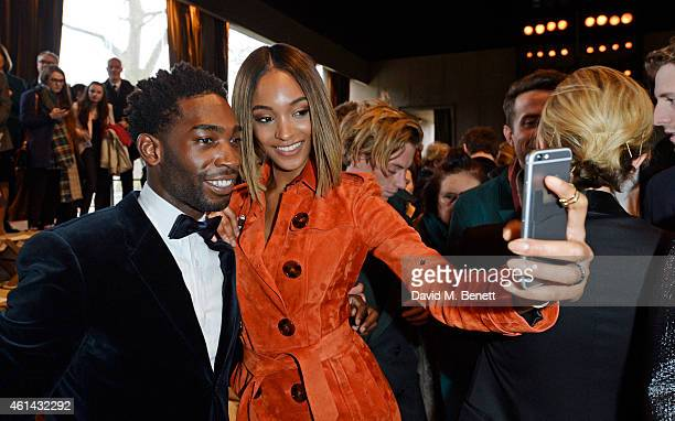 Tinie Tempah and Jourdan Dunn attend the front row at Burberry Prorsum AW15 London Collections: Men at Kensington Gardens on January 12, 2015 in...
