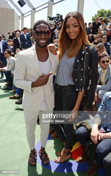 Tinie Tempah and Jourdan Dunn attend the front row at Burberry Prorsum SS15 during London Collections Men at Kensington Gardens on June 17 2014 in...