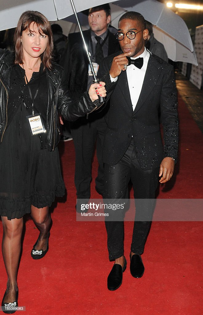 Tinie Tempah arrives rain-soaked at the 18th anniversary MOBO Awards at The Hydro on October 19, 2013 in Glasgow, Scotland.